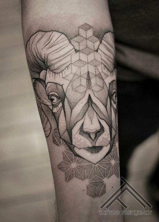 Geometrical style black ink arm tattoo of goat head with ornaments