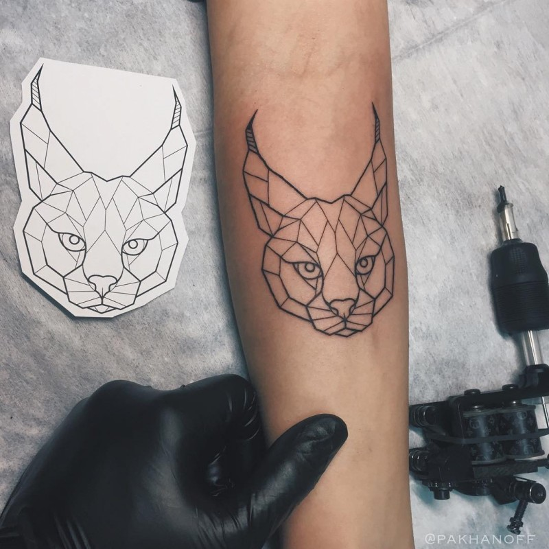 Geometrical style black ink arm tattoo of caracal head