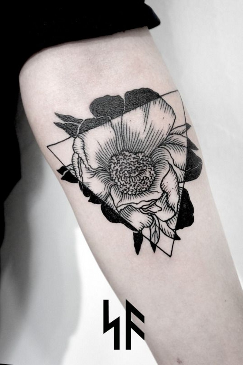 Geometrical style black ink flower with triangle tattoo on arm