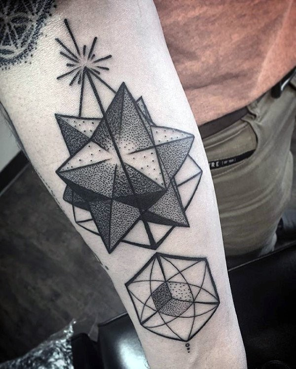 Geometrical style black ink forearm tattoo painted in dot style
