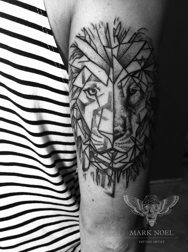 Geometrical style black ink lion tattoo on arm