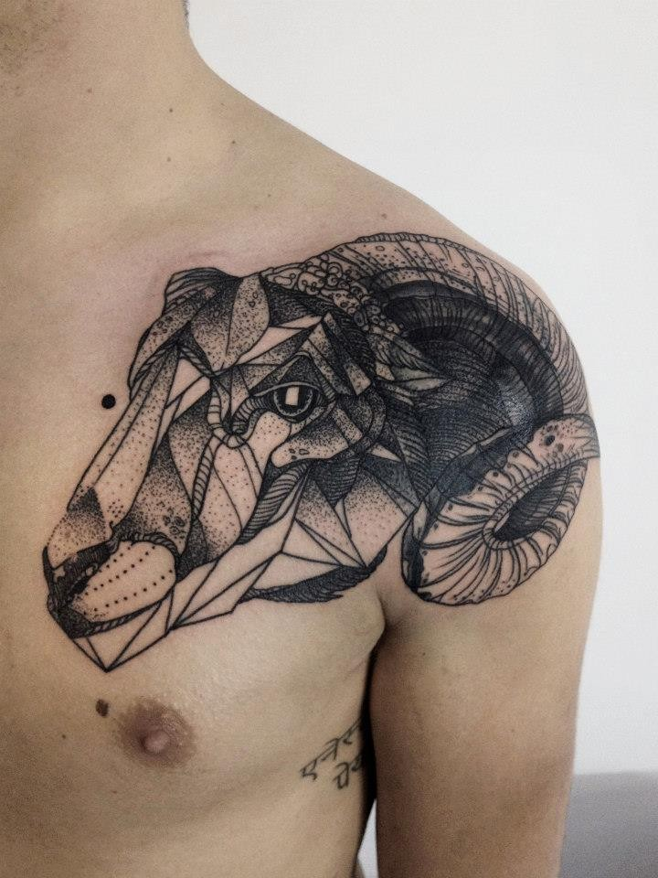 Geometrical style black ink painted by Michele Zingales collarbone tattoo of goat head