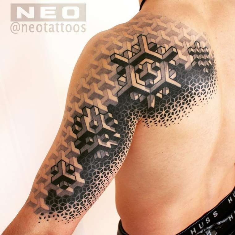 Geometrical style black ink scapular and shoulder tattoo of geometrical ornaments