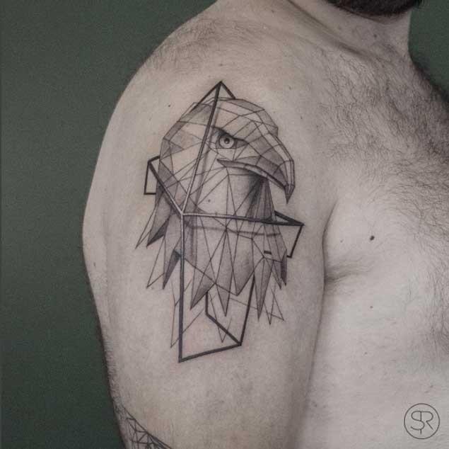 Geometrical style black ink shoulder tattoo of eagle head