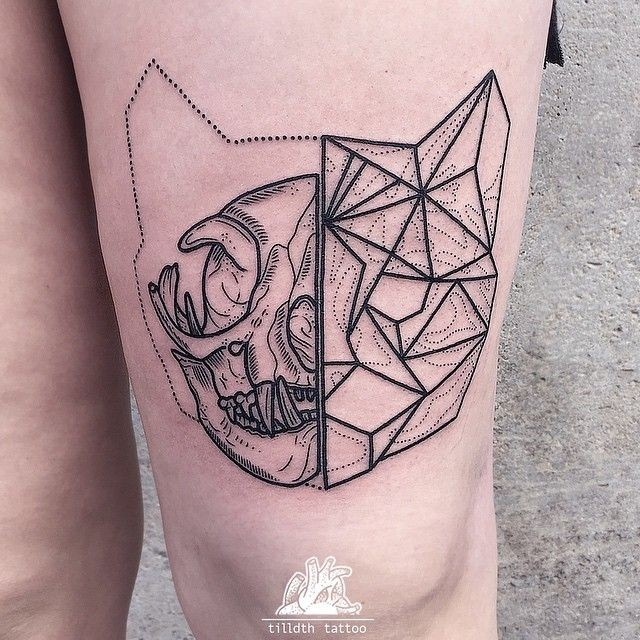 Geometrical style black ink thigh tattoo of cat head
