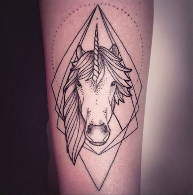 Geometrical style black ink unicorn tattoo on forearm with figures