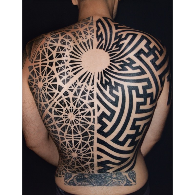 Geometrical style black ink whole back tattoo of various ornaments