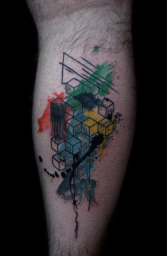 Geometrical style colored leg tattoo