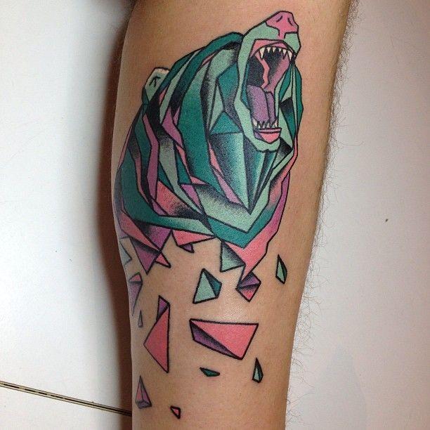 Geometrical style colored leg tattoo of roaring bear head