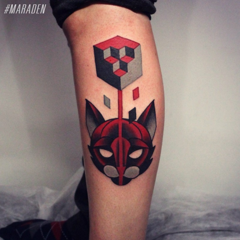 Geometrical style colored leg tattoo of cat and cube