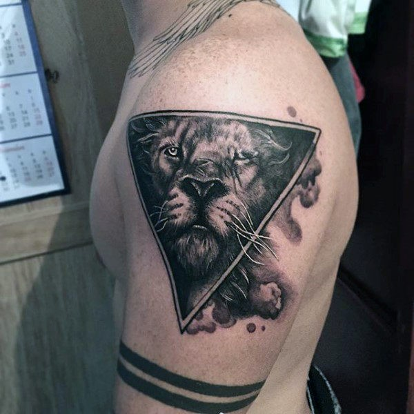 Geometrical style detailed shoulder tattoo of triangle stylized with lion face