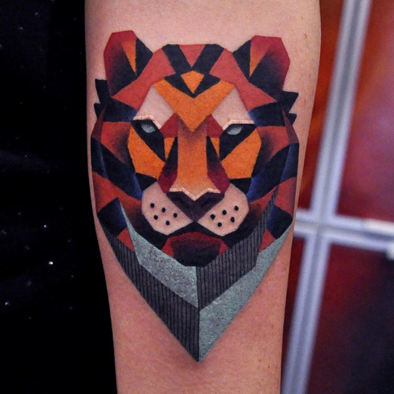 Geometrical Style Painted Colored Lion Portrait Tattoo On Arm