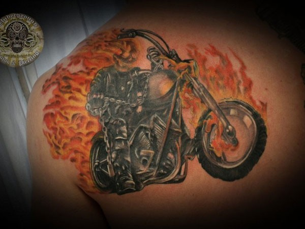 Ghost rider in flames tattoo on back