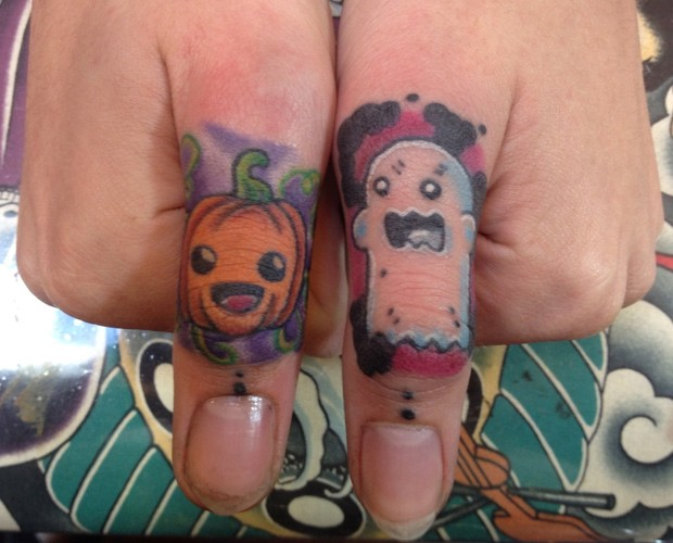 Ghost tattoo with pumpkin on fingers