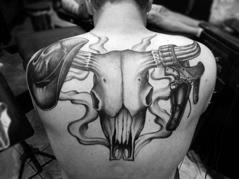 Giant bull skull with cowboy&quots hat and revolver on horns tattoo on back
