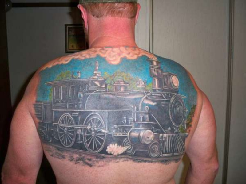 Giant colored detailed steaming naturally looking train tattoo on upper back