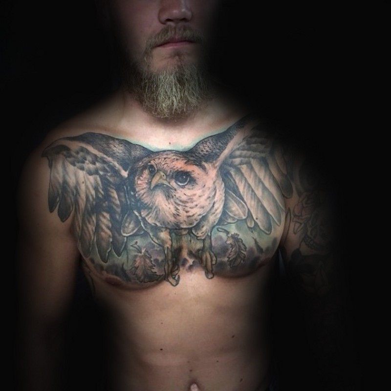 Giant flying owl realistic wildlife chest traditionally colored tattoo