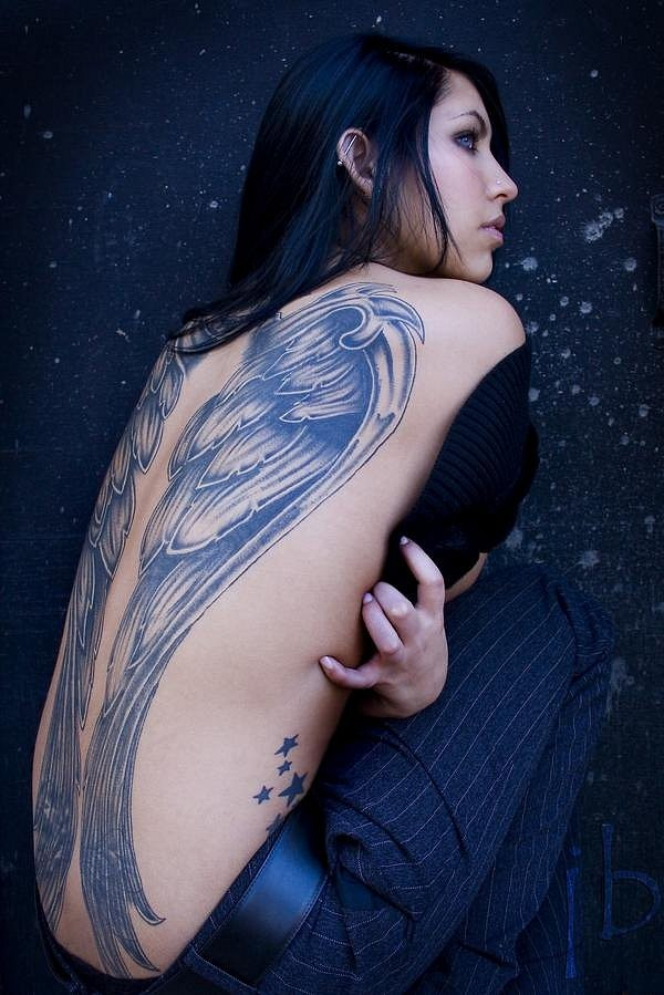 Giant pair of feather wings detailed tattoo on whole back