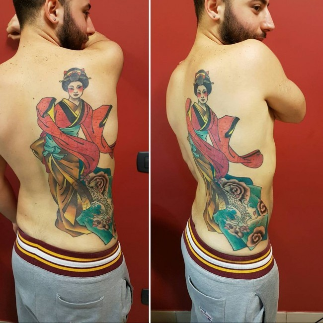 Giant traditionally colored Asian Geisha in long kimono with bright make up back tattoo