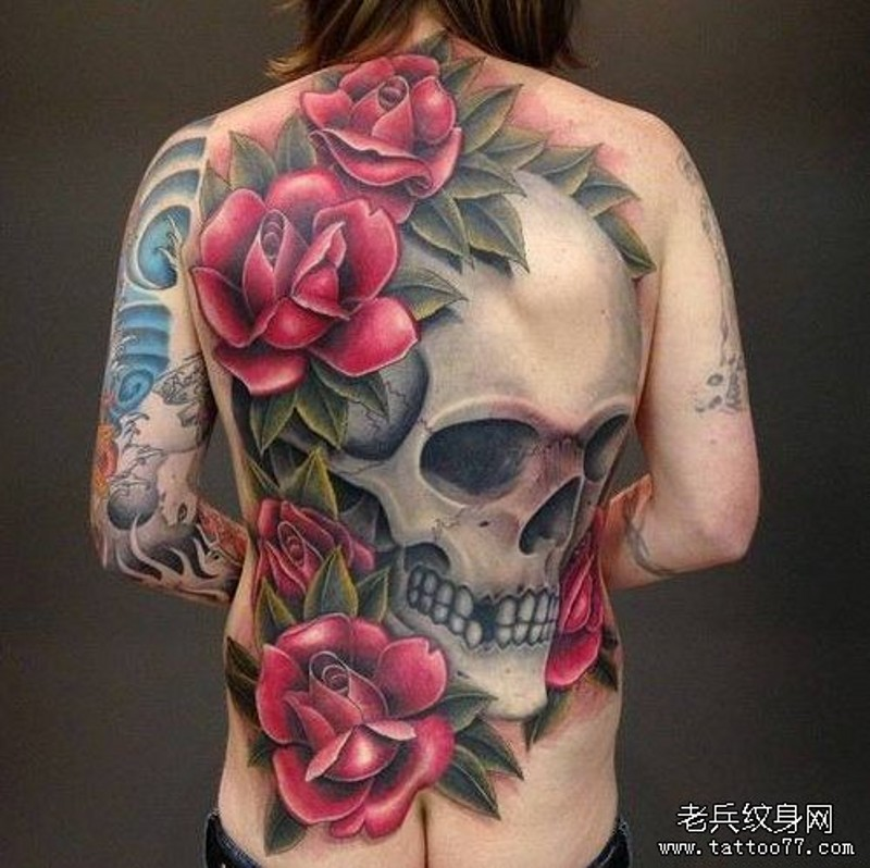 Giant whole back human skull and huge red roses colored realistic tattoo