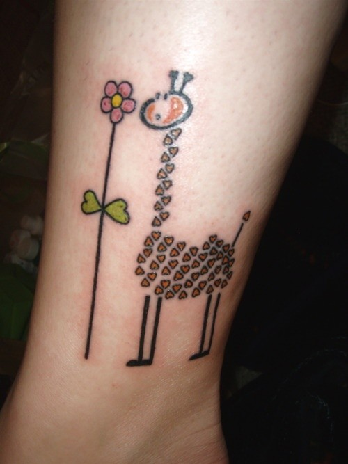 Giraffe with flower tattoo on ankle