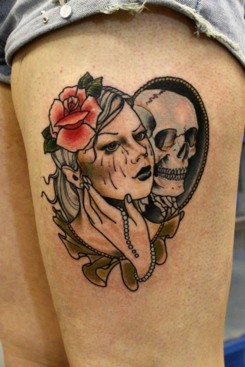 Girl and reflection skull in a mirror tattoo on thigh