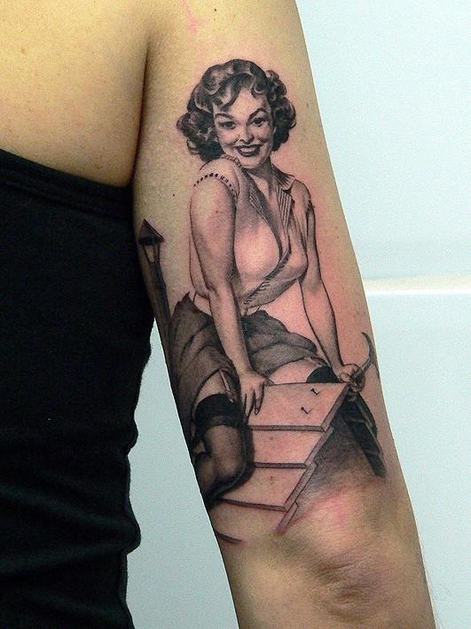 Girl hammer nails pin up tattoo by Xavier Garcia