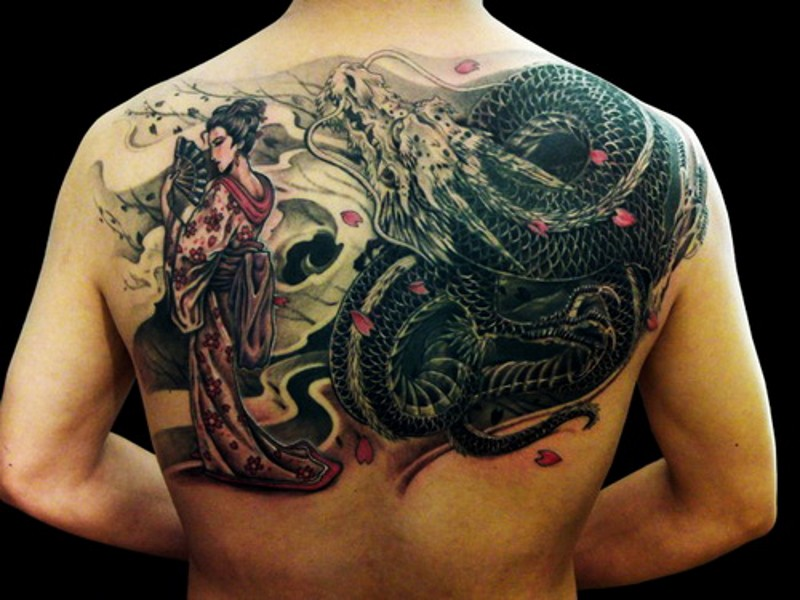 Glamorous colored detailed looking Asian upper back tattoo of dragon and beautiful geisha