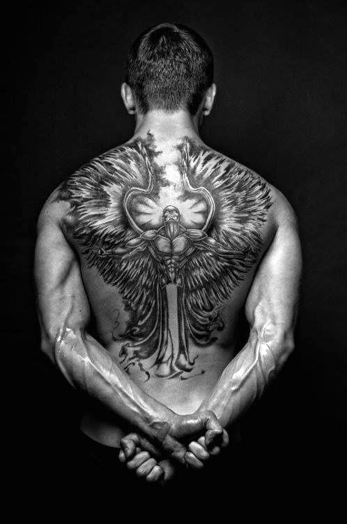 Glorious black and white angel tattoo on whole back