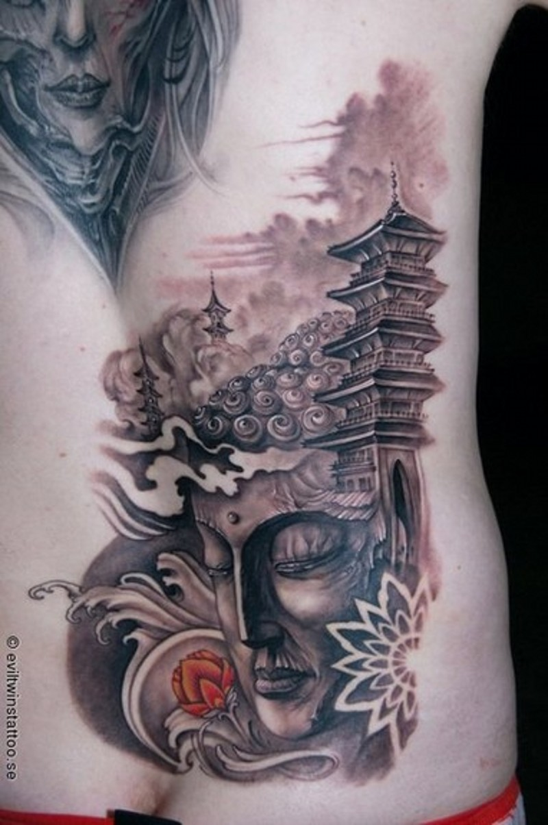 Glorious detailed Buddha statue tattoo on back with old temple and lotus