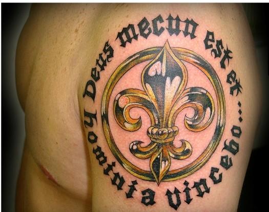 Gold fleur de lis and black inscription tattoo on shoulder for Black gold tattoo