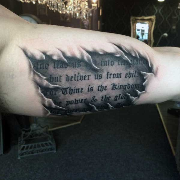 Gorgeous antic lettering like ripped skin tattoo on arm
