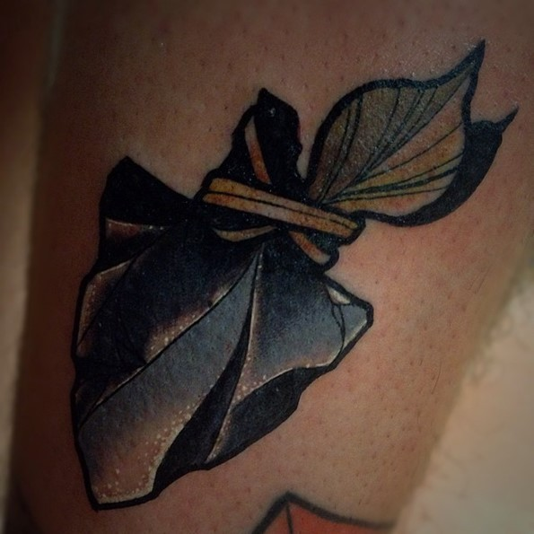 Gorgeous beautiful designed natural looking arrow head tattoo stylized with little leaves