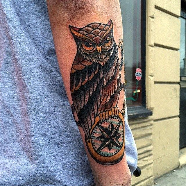 Gorgeous black and gray american classic tattoo with owl on arm