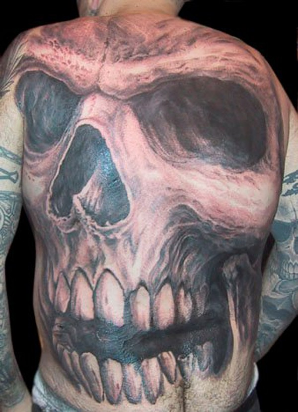 Gorgeous black and gray style spectacular looking whole back tattoo of human skull
