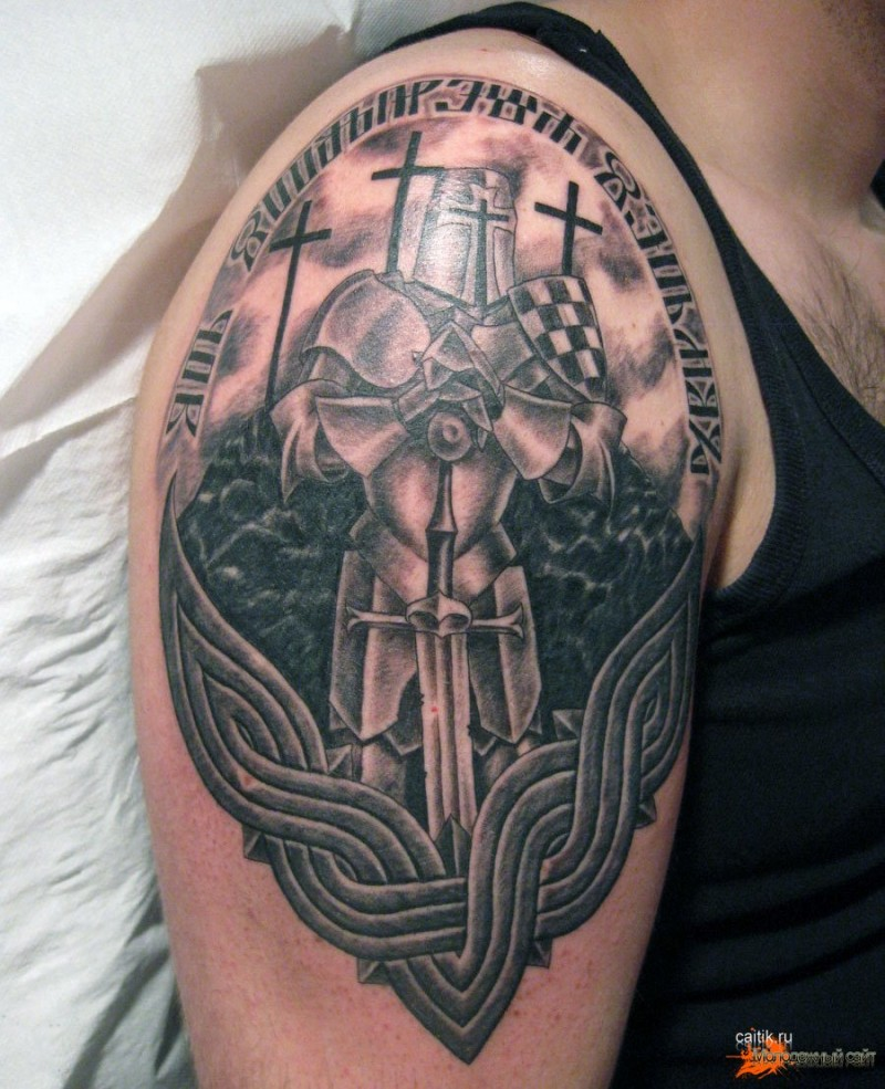 Gorgeous black and white Celtic shoulder tattoo of medieval knight with lettering
