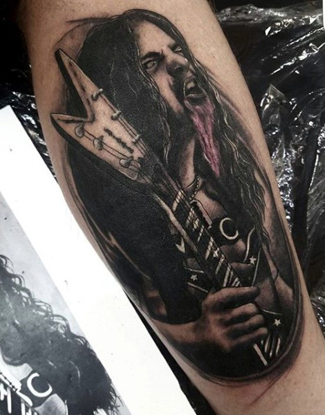 Gorgeous black and white creepy rock star tattoo on leg