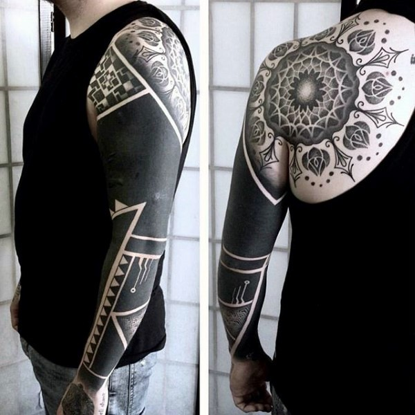Gorgeous black and white detailed flower tattoo on shoulder stylized with tribal ornament on sleeve