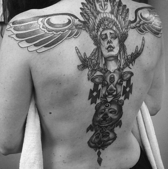 Gorgeous black and white mystic Indian statue tattoo on whole back