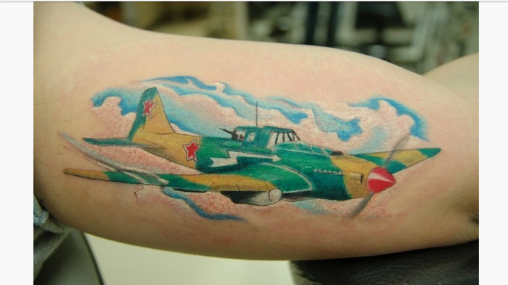 Gorgeous black ink biceps tattoo of vintage fighter plane