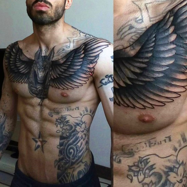 Gorgeous black ink chest tattoo of Egypt God with wings