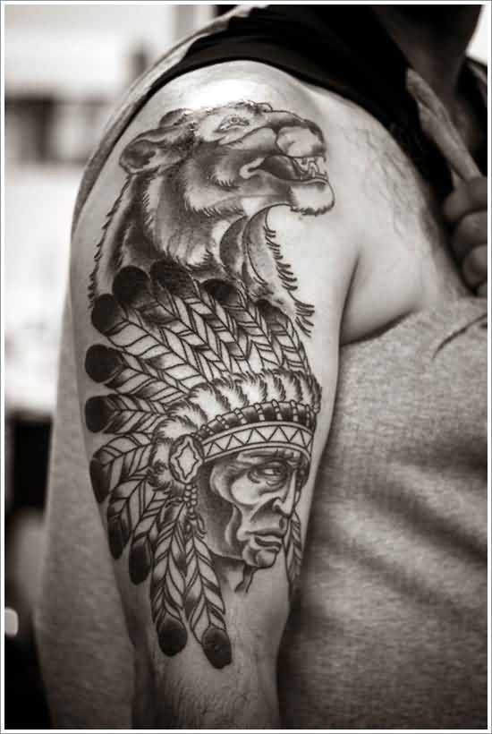 Gorgeous black ink detailed Indian tattoo on shoulder with lion