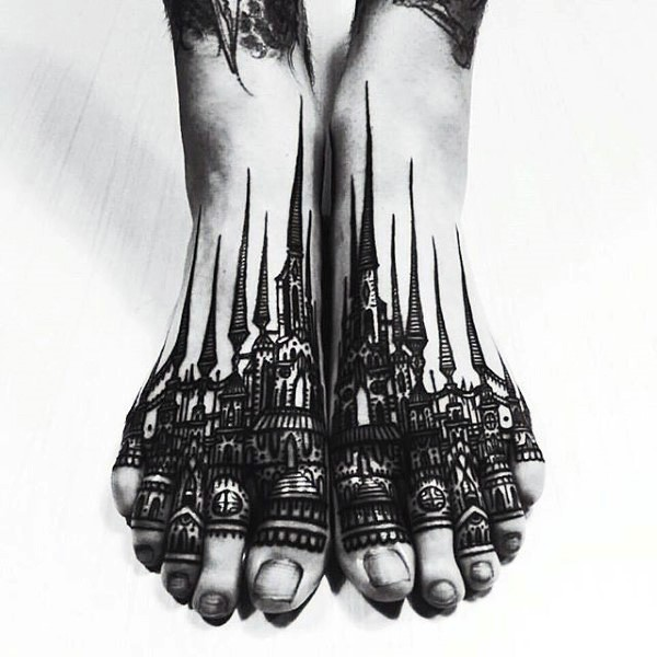 Gorgeous black ink henna old city tattoo on feet