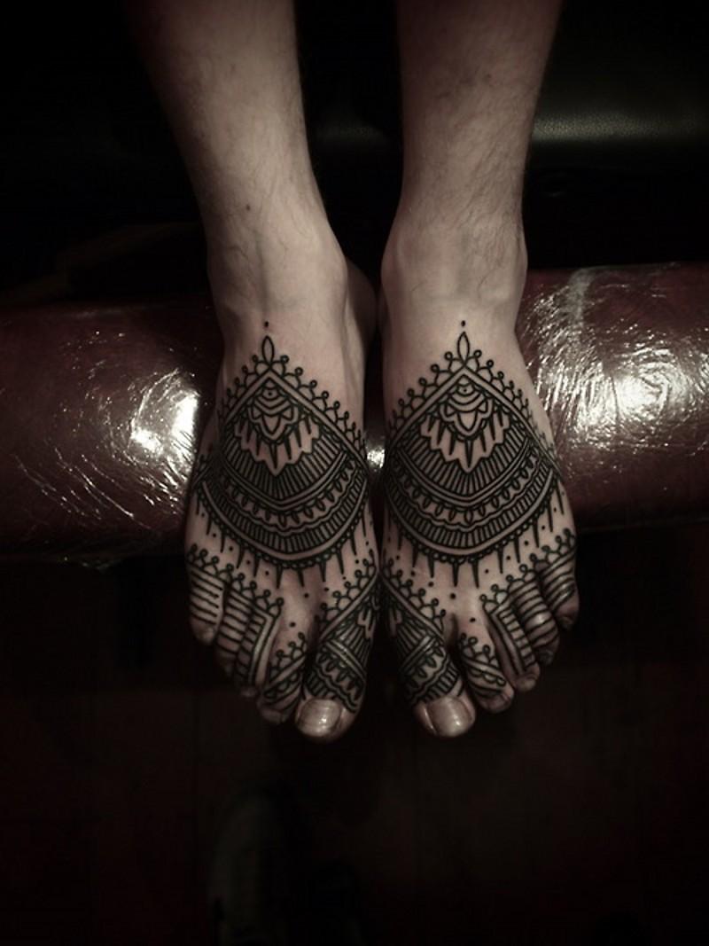 Gorgeous black ink Hinduism style henna tattoo on feet
