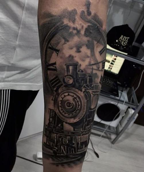 Gorgeous black ink old steamy train with clock tattoo on arm