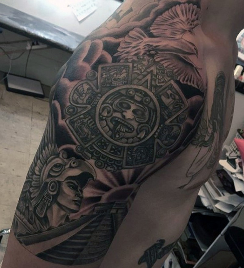 5cf71dbbb Gorgeous black ink shoulder tattoo of Mayan warrior with temple and pigeon