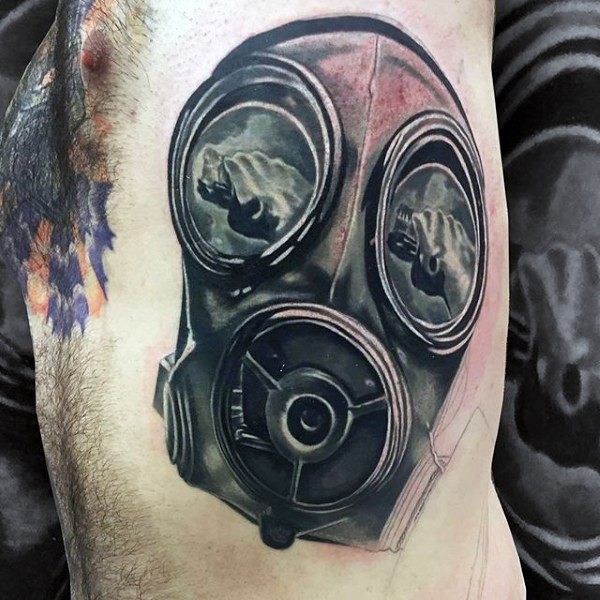 Gorgeous black ink side tattoo of gas mask