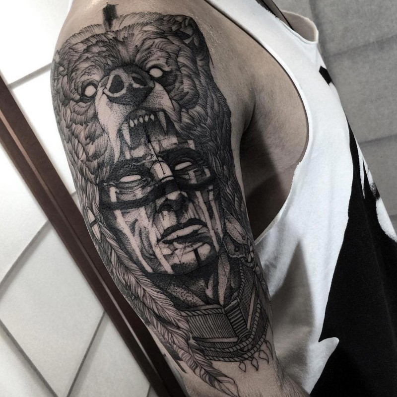 69d099bac Gorgeous black ink upper arm tattoo of mystical antic tribal man with bear  helmet