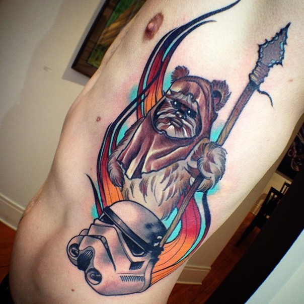Gorgeous cartoon like colored side tattoo of ewok and storm troopers helmet