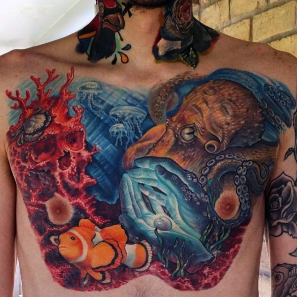 Gorgeous colorful underwater life with animals tattoo on chest